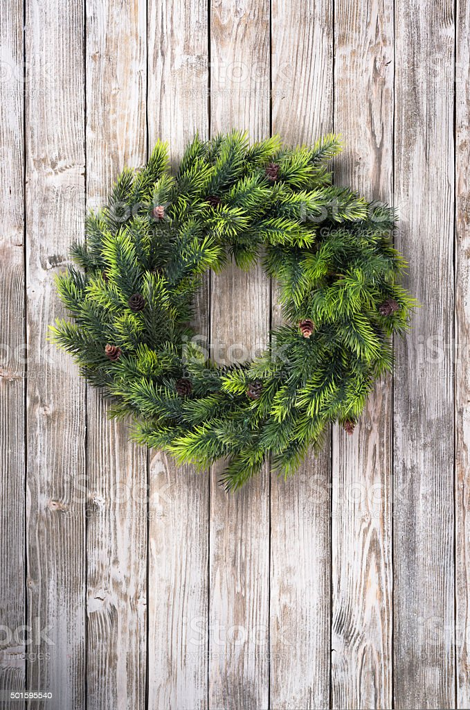 Christmas wreath on wooden door stock photo