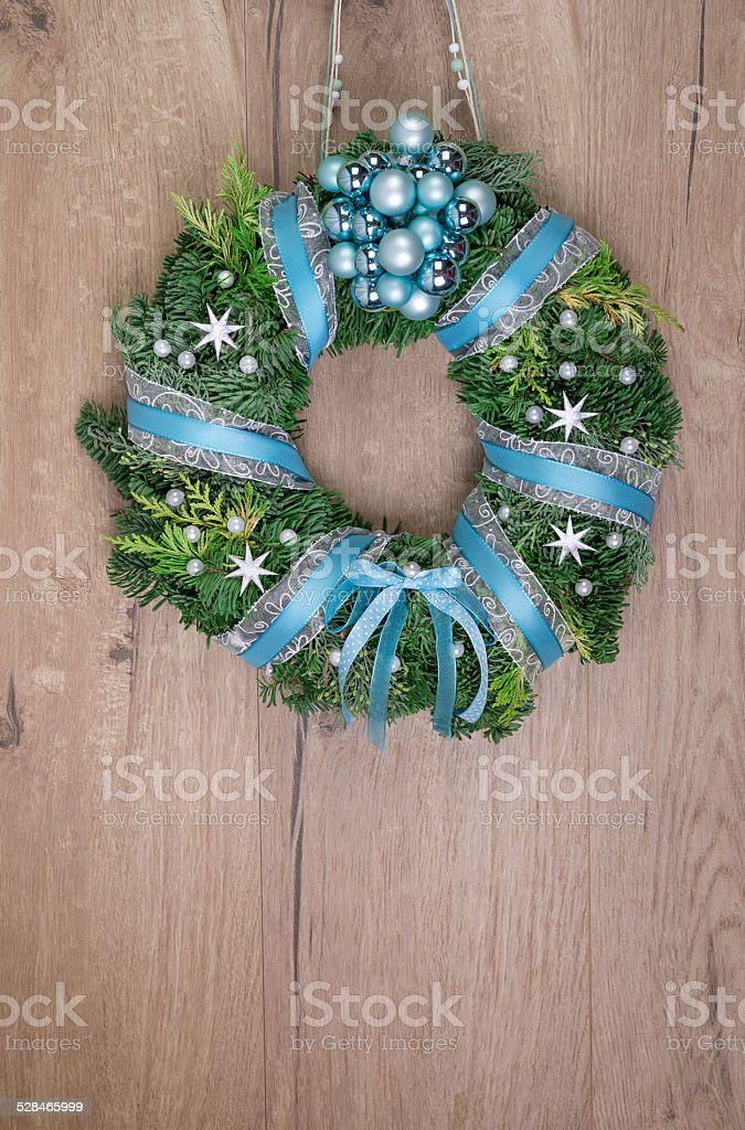 Christmas wreath on wooden door, space for your text stock photo
