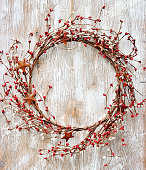 Christmas wreath with berries and rusty metal star