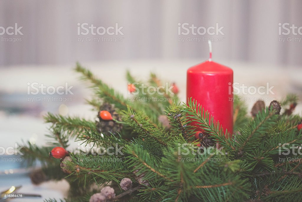 Christmas wreath with candle on table, patties on table stock photo