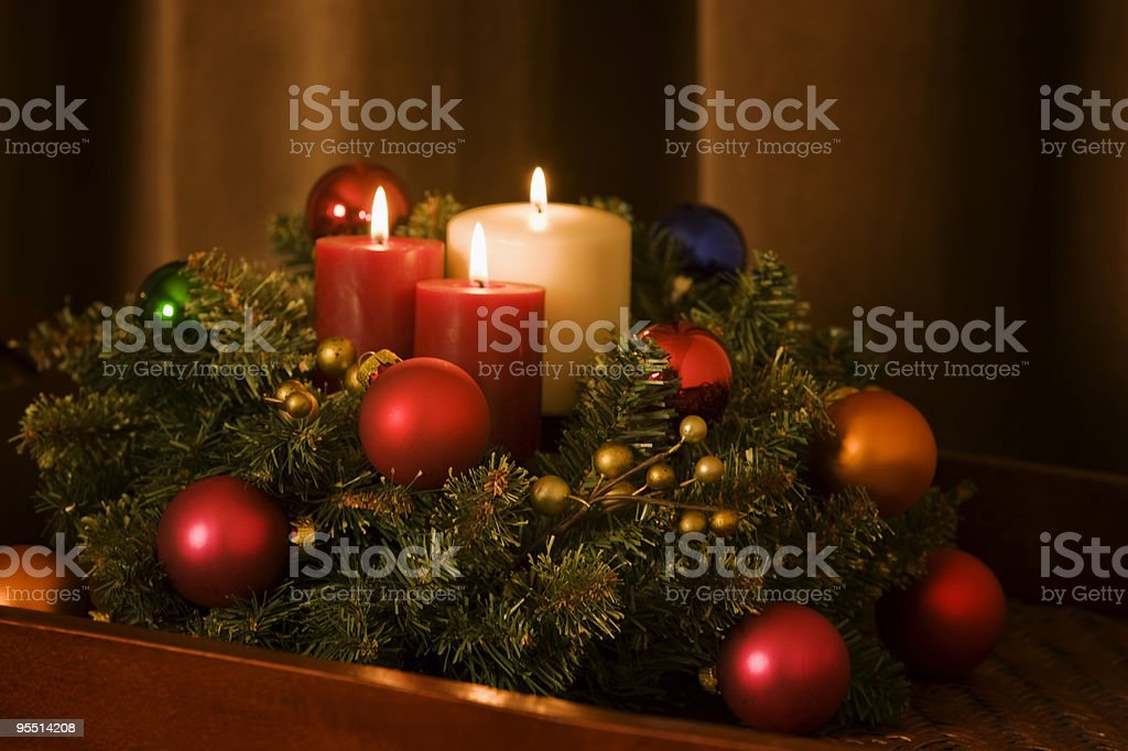 Christmas wreath with candles and decorations stock photo
