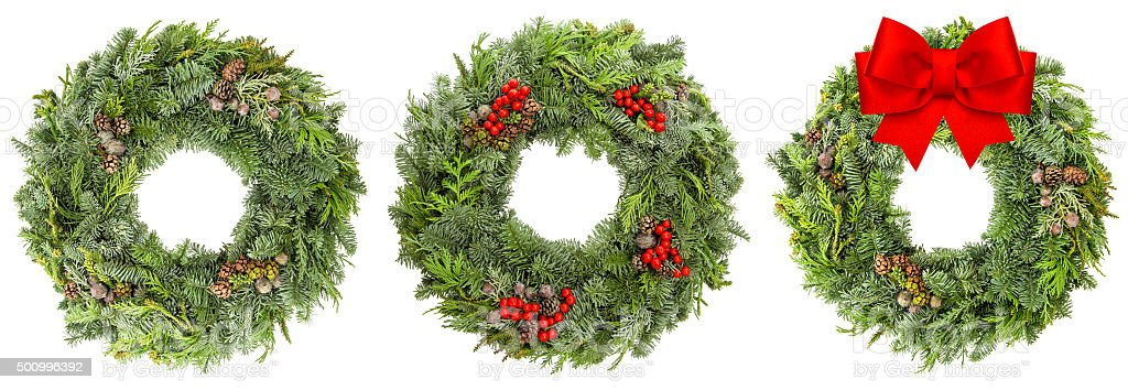 Christmas wreath with cones red berries ribbon bow stock photo