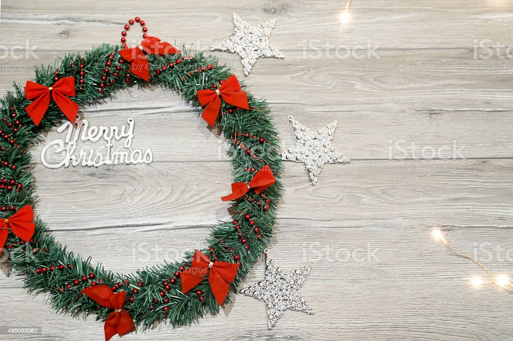 Christmas wreath with decorations on the shabby wooden background stock photo