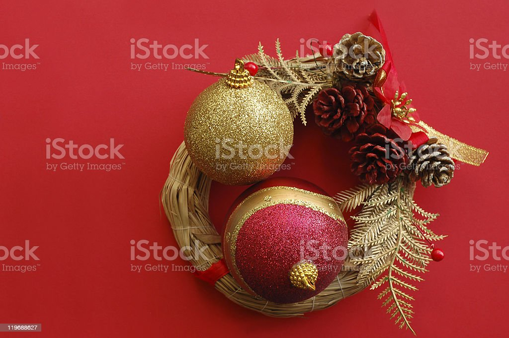 Christmas wreath with two decorative balls in it royalty-free stock photo