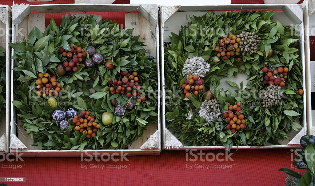 Christmas Wreaths at the Market royalty-free stock photo