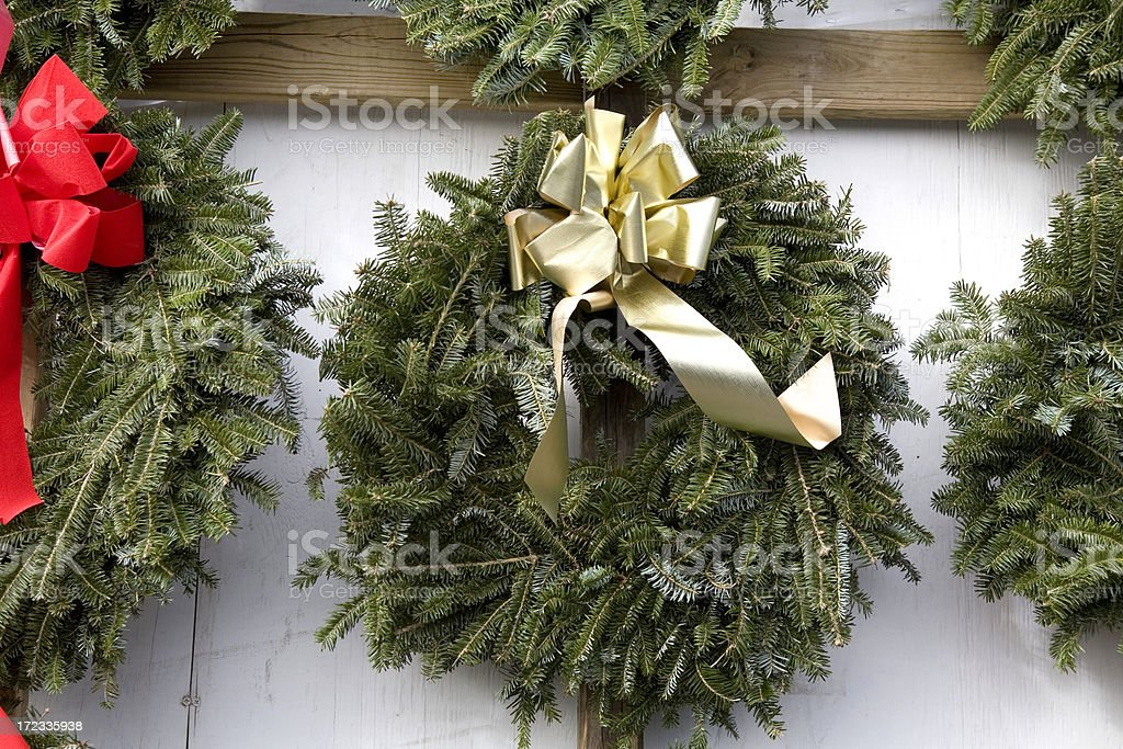 Christmas Wreaths on Wall for Sale royalty-free stock photo