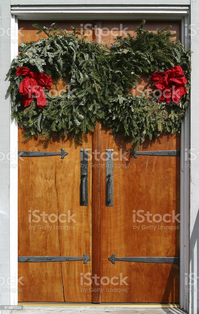 Christmas Wreaths on Wooden Doors royalty-free stock photo