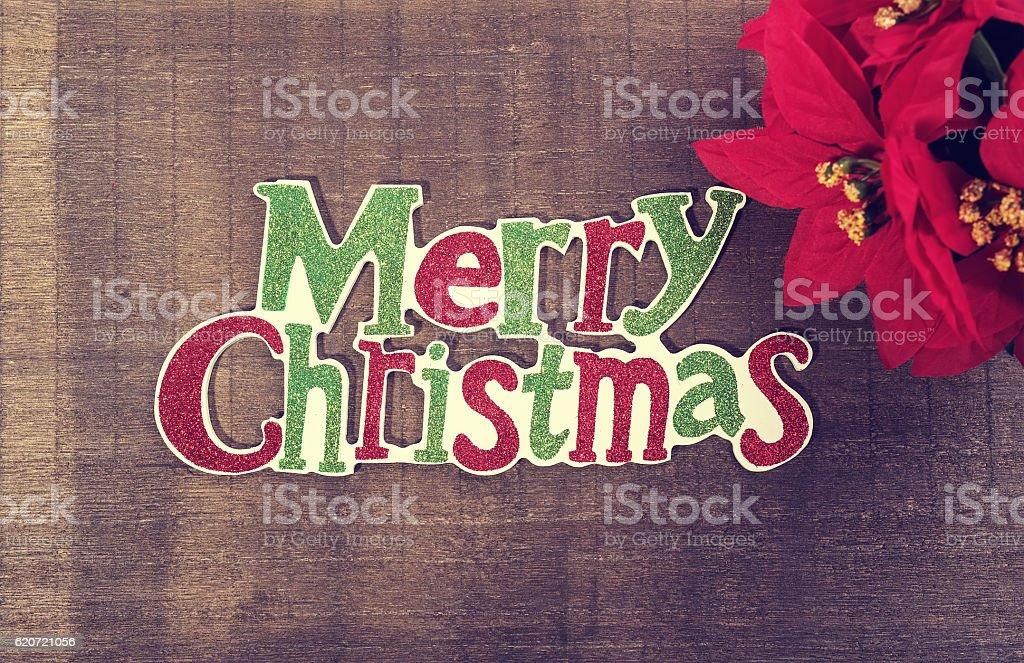 Christmas written on wooden background stock photo