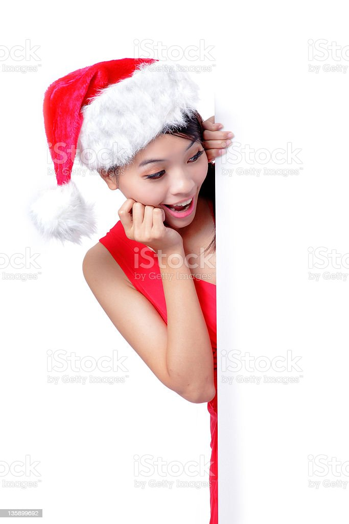 christmas young girl showing blank billboard royalty-free stock photo