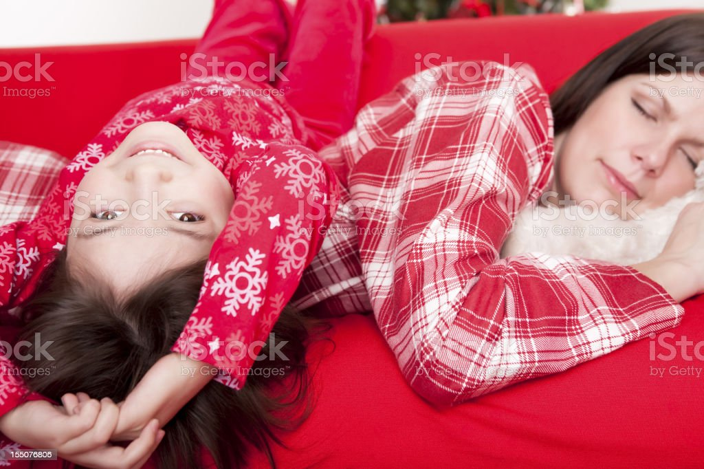 Christmas-Daughter lying on mother's back royalty-free stock photo