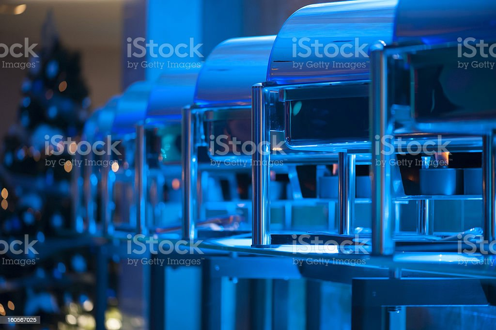 Christmass banquet chafings in blue light stock photo