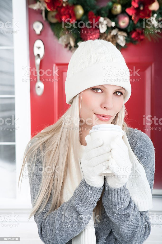 Christmas-Smiling woman holding cup of coffee royalty-free stock photo