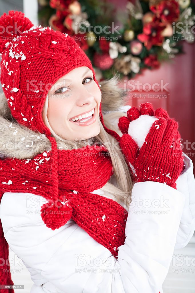 Christmas-Smiling woman holding snowball outside royalty-free stock photo
