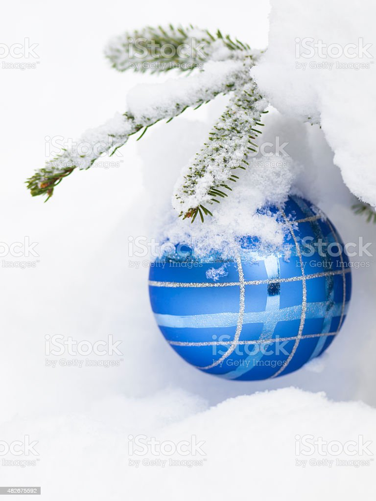 Christmast ball with snow on tree for card stock photo