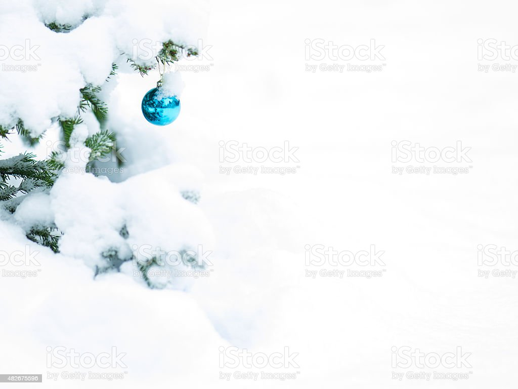 Christmast balls with lot of snow on tree for card stock photo