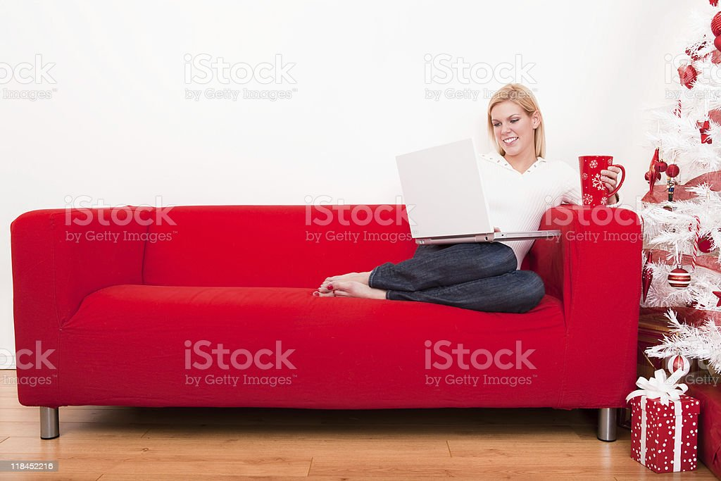 Christmas-Woman using laptop royalty-free stock photo