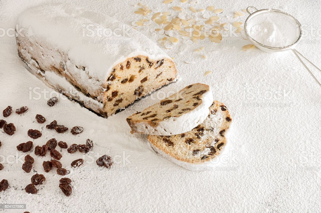 Christstollen on White Icing Sugar stock photo