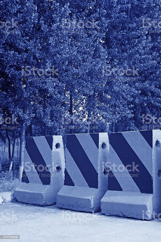 chromatic cement traffic isolation pier stock photo