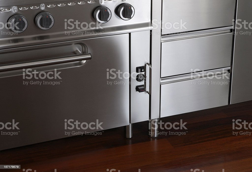 Chromatic kitchen oven and drawers detail stock photo