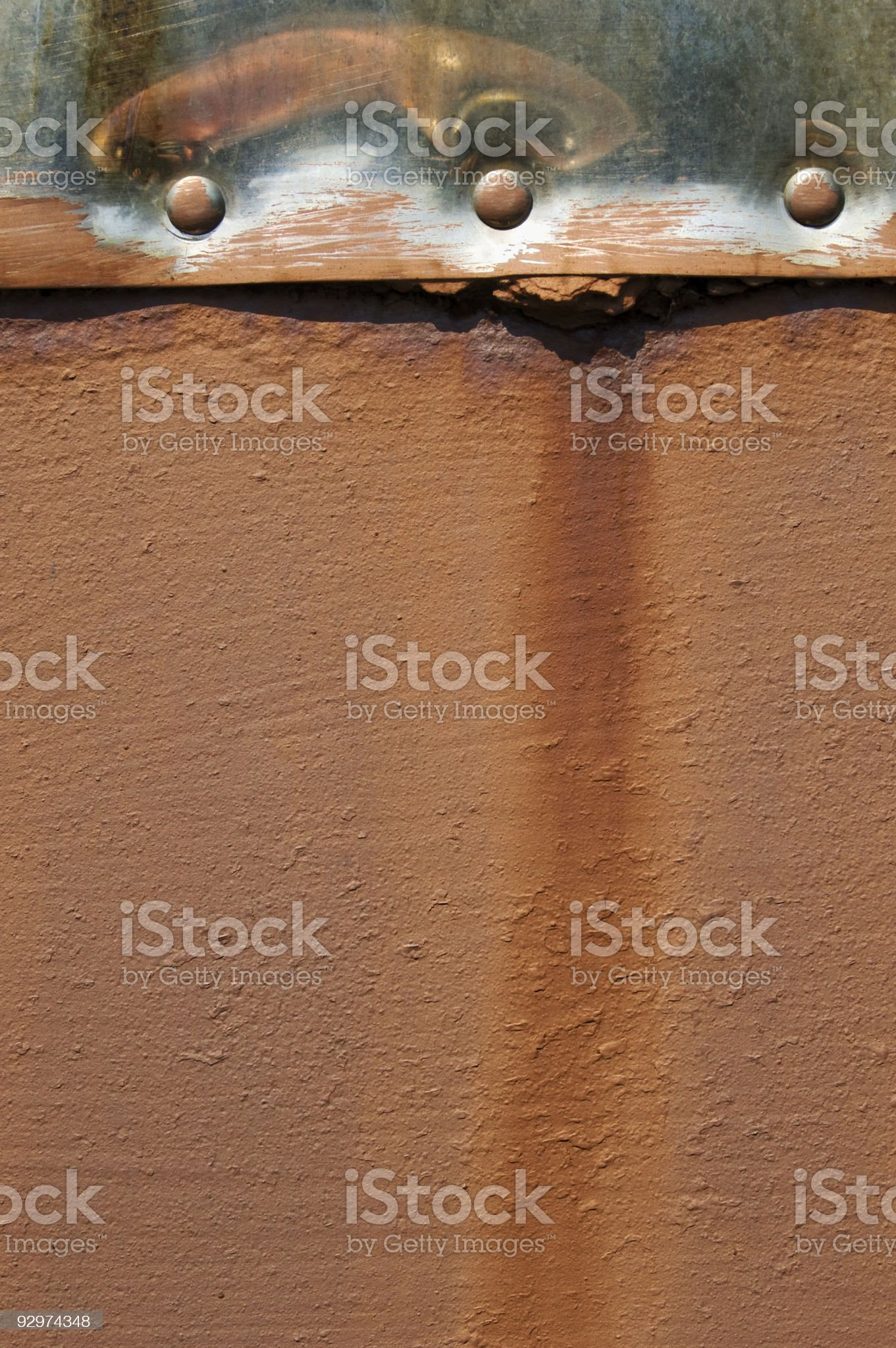 Chrome and rust stained brown background royalty-free stock photo