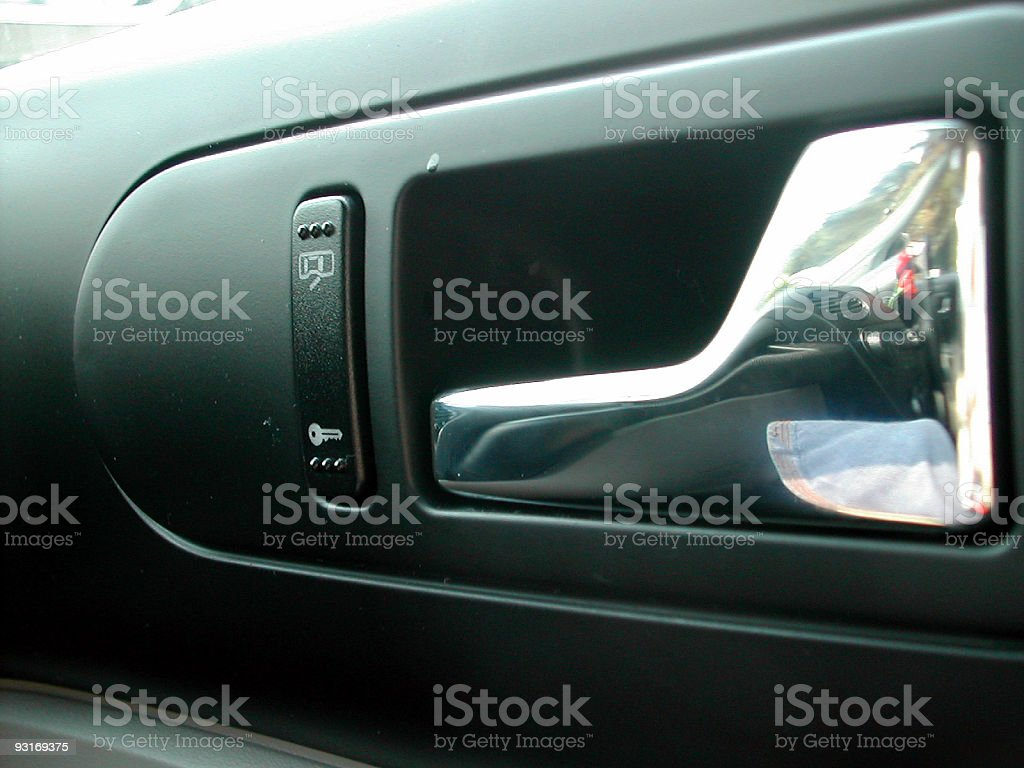 chrome car door handle (inside) royalty-free stock photo