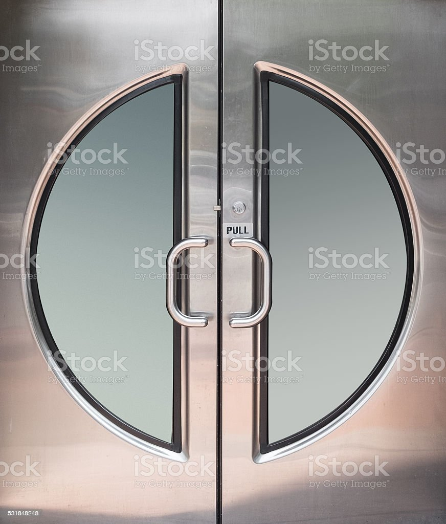 Chrome Circular Double Door stock photo