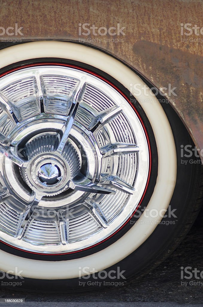 Chrome Hubcap on 1950 Automobile stock photo