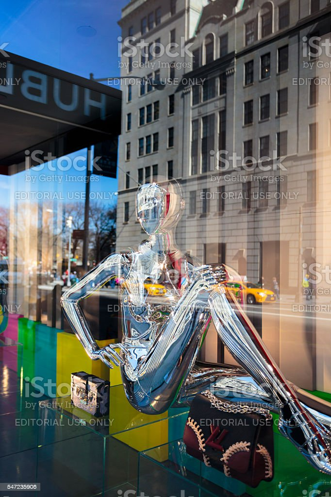 Chrome manikin in window stock photo