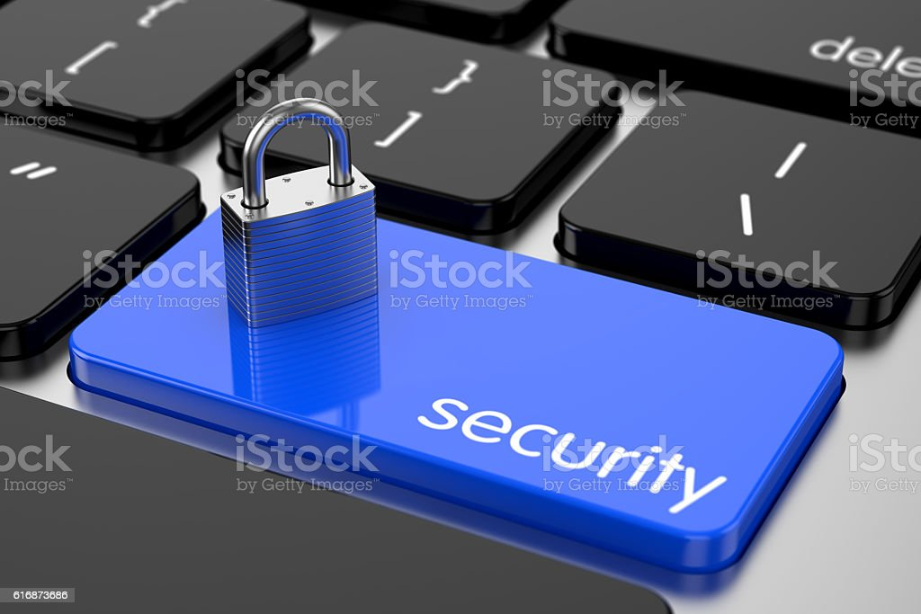 Chrome padlock on the computer keyboard. Security concept stock photo