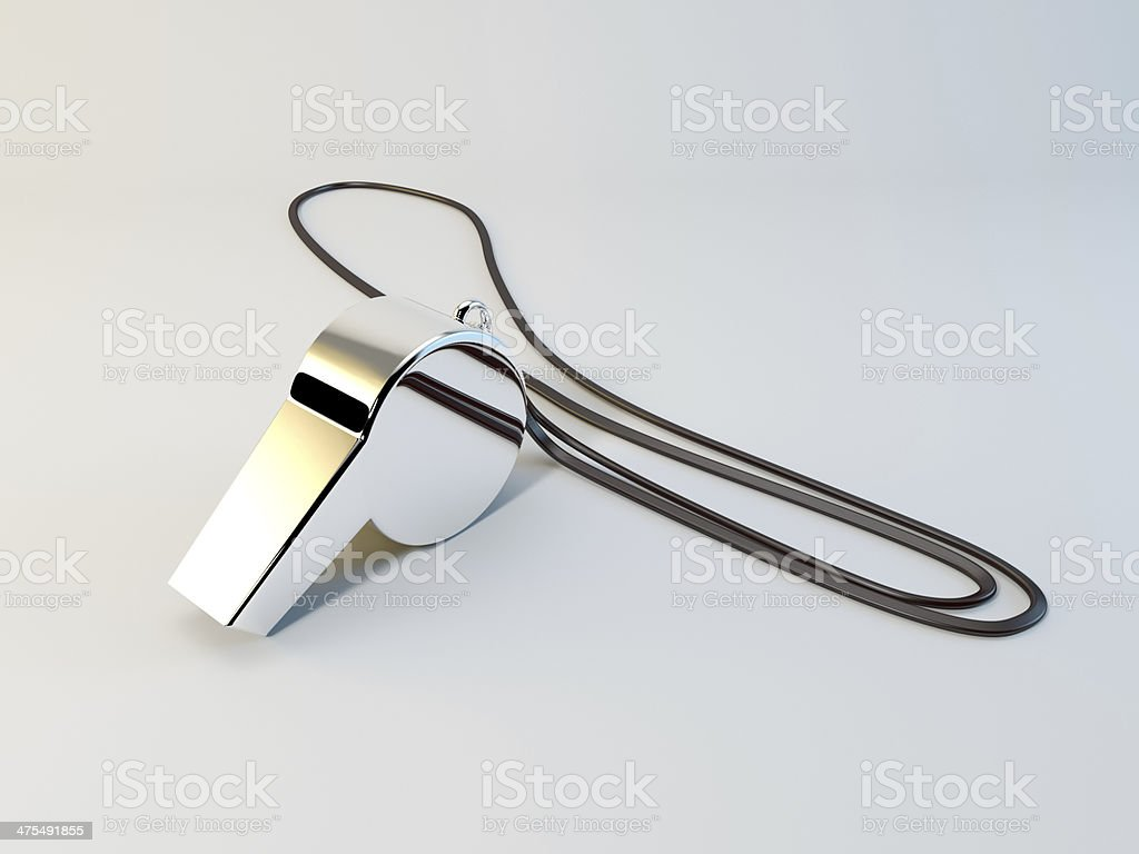 Chrome plated coaches whistle with a lanyard isolated on white. stock photo