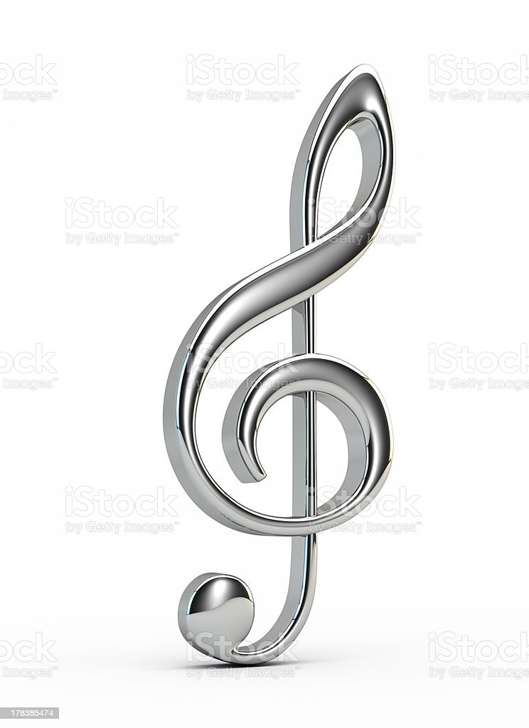 Chrome plated treble clef on white background stock photo