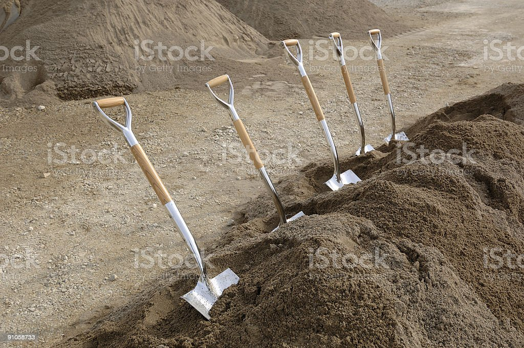 Chrome Shovels in Dirt royalty-free stock photo