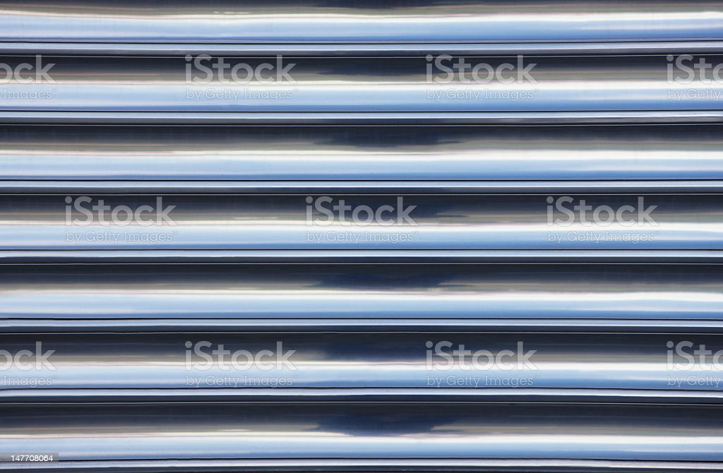 Chrome texture on the side of a train stock photo