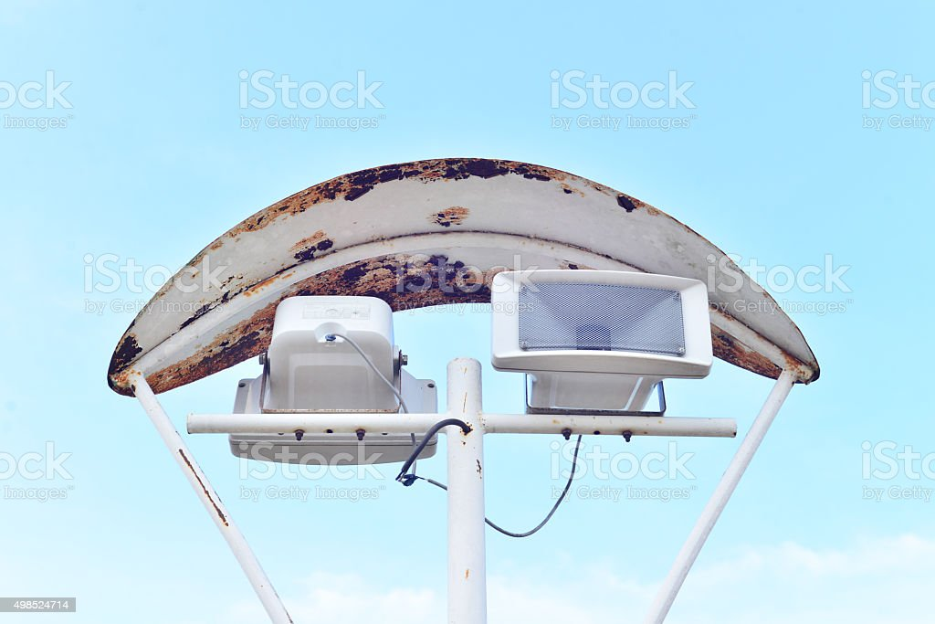Chromed loudspeakers with sky background and sound wave effect stock photo