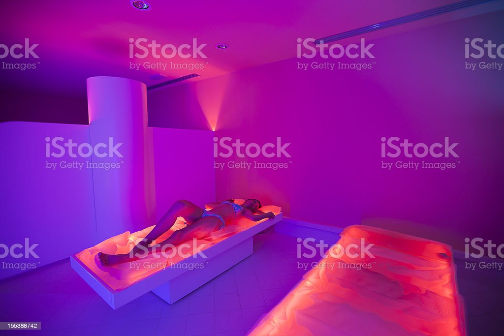 Chromotherapy: relax on heated mattress stock photo