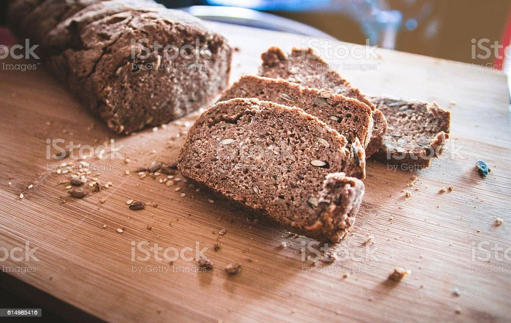 Chrono, organic bread with various seeds on wooden board stock photo