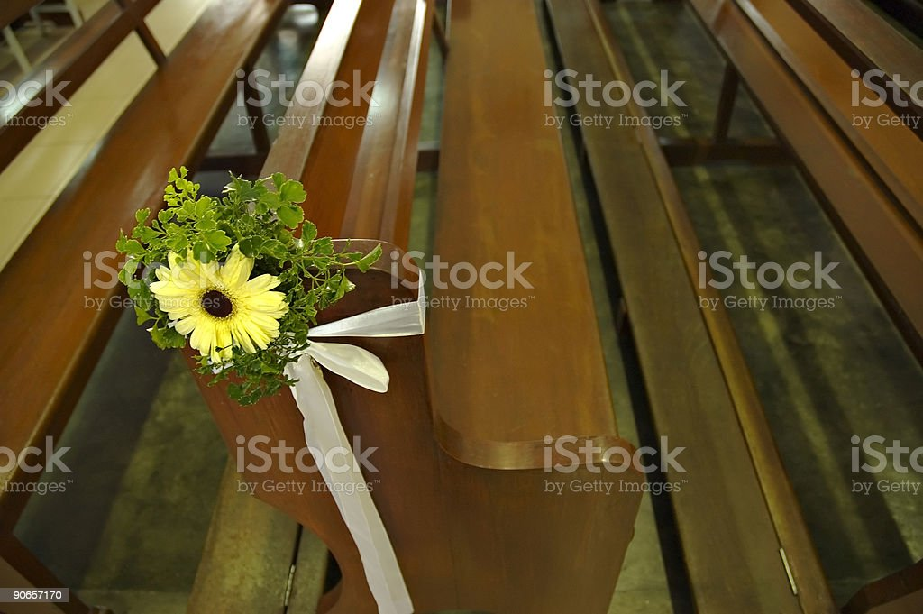 Chrysanthemum flower tied to the pew royalty-free stock photo