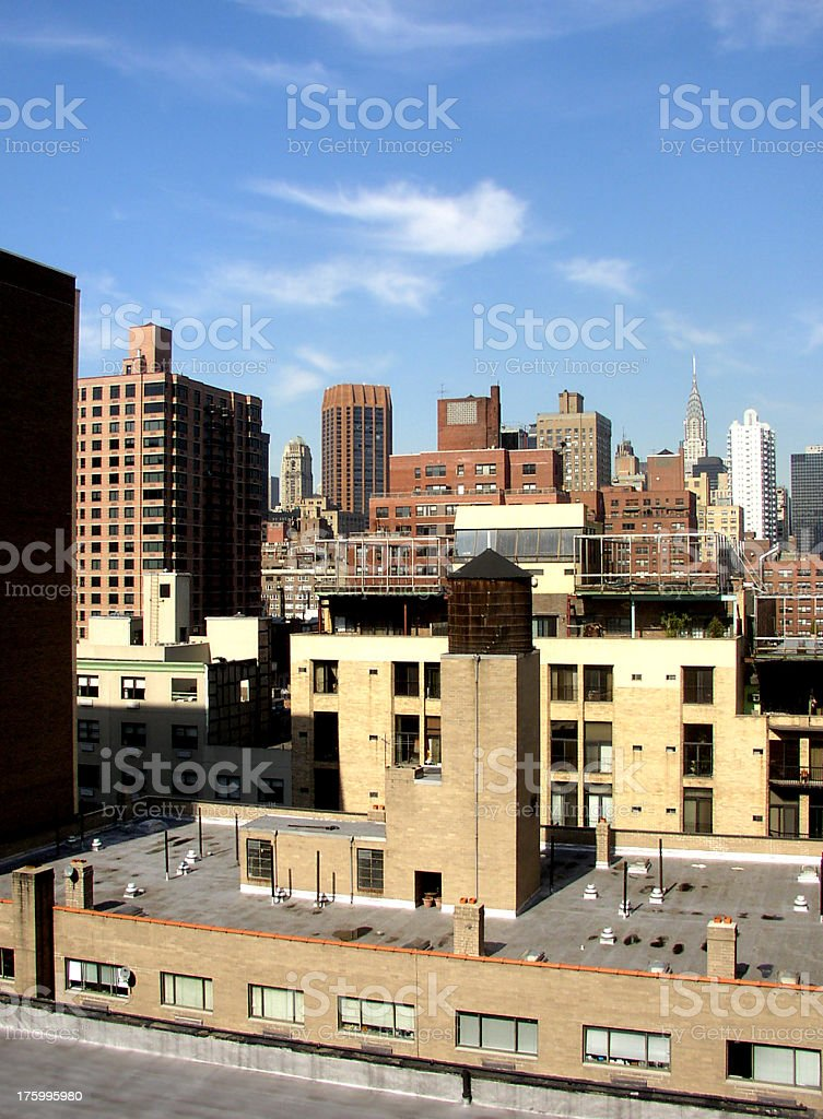 Chrysler Building over NYC Rooftops royalty-free stock photo