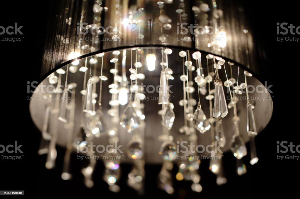 Chrystal chandelier close-up. Glamour black and white background with stock photo