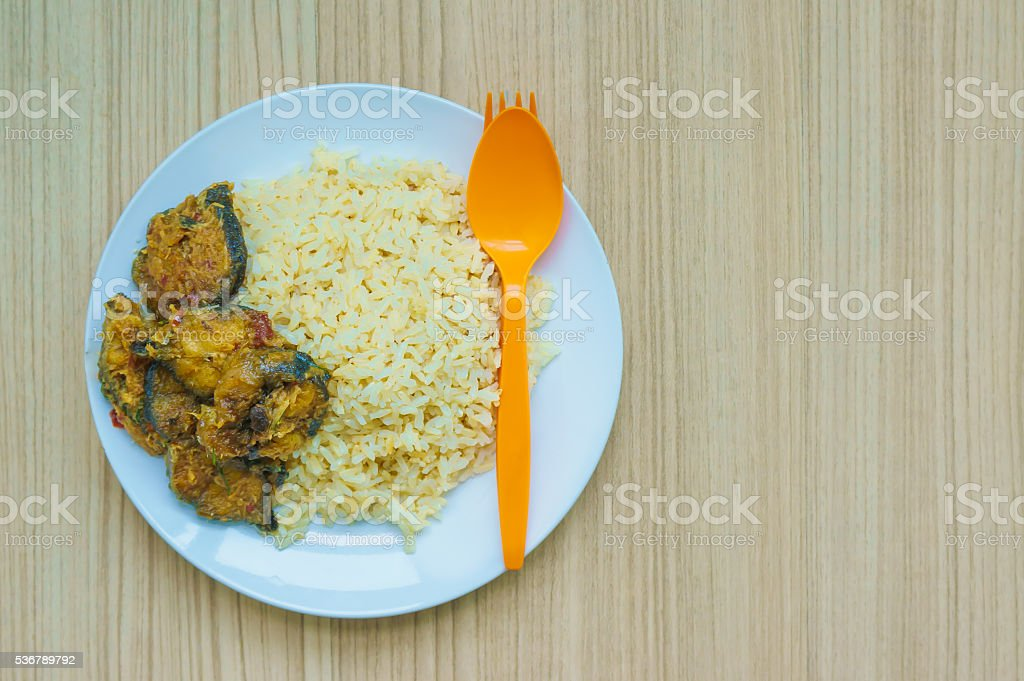 chu chi pla with steamed rice stock photo