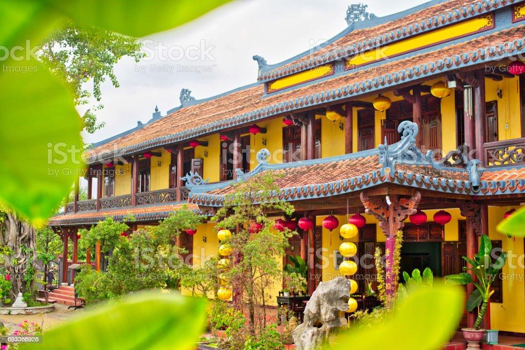 Chua Phap Bao buddhist temple with little bonsai tree in yard. stock photo