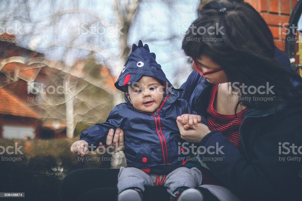 Chubby baby in chicken jacket stock photo