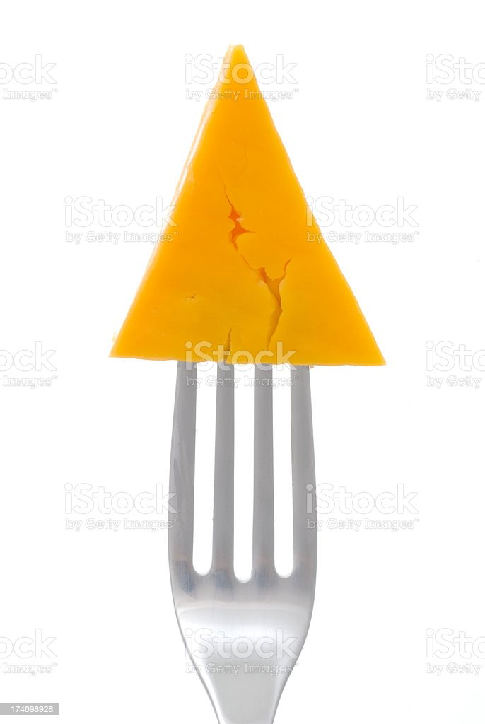 Chunk of cheese on a fork stock photo