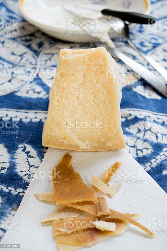 chunks and rind of parmigiano cheese stock photo