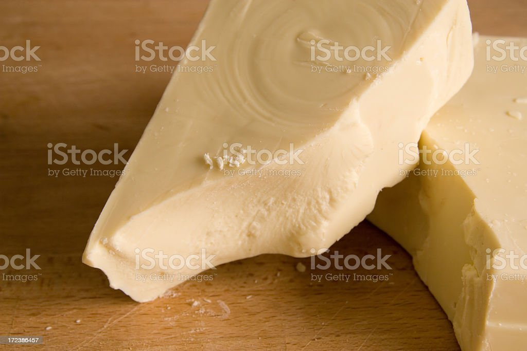 Chunks of broken off white chocolate stock photo