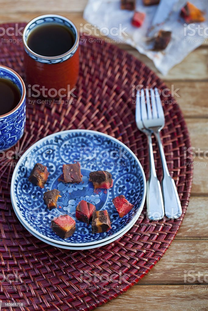 Chunks of chocolate and creamy rainbow fudge on the plate royalty-free stock photo