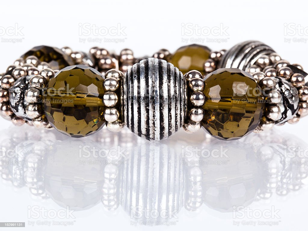 Chunky beaded bracelet in pewter and taupe with reflection stock photo