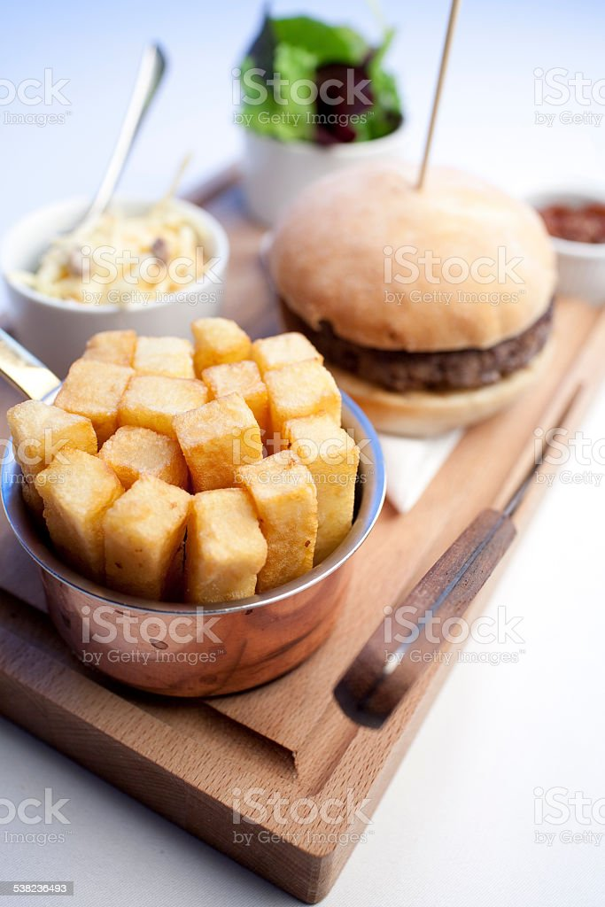 Chunky Chips/Fries with burger stock photo