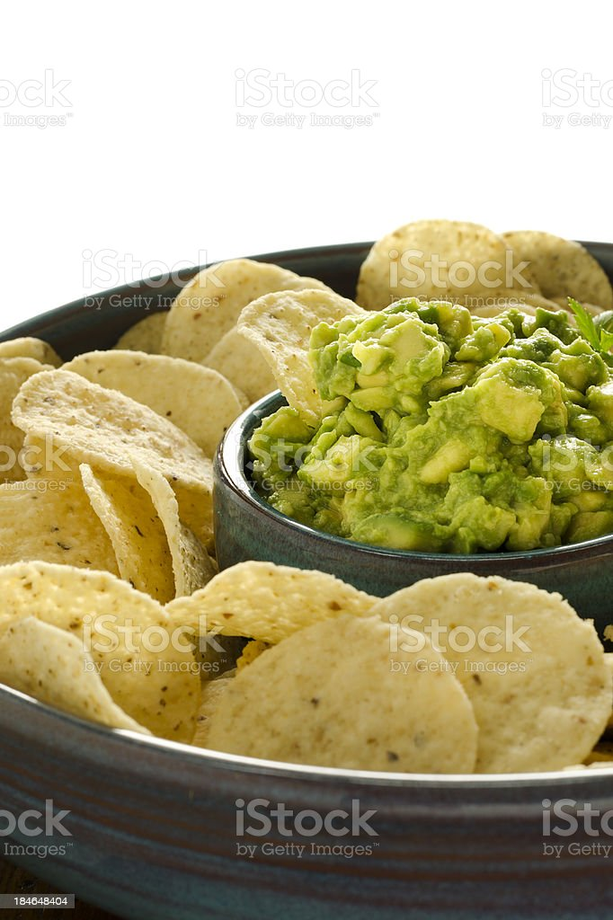 Chunky Guacamole and Corn Chips Isolated on White stock photo