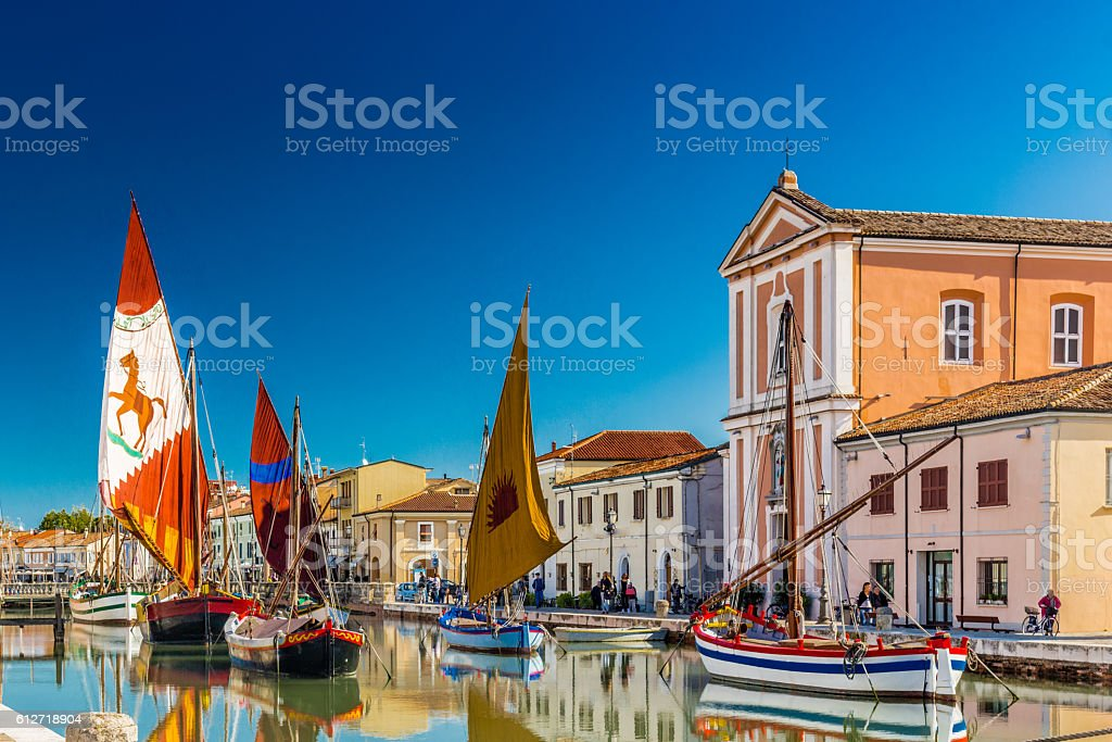 Church and ancient sailboats on Canal Port stock photo